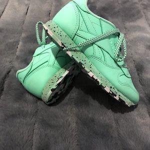 Reebok sneakers.